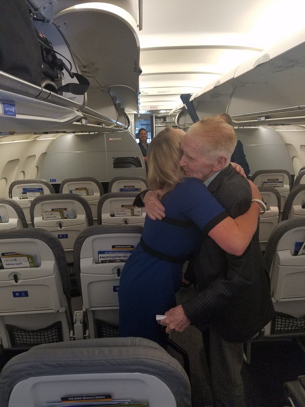 Natasha surprises Mr. McEneaney on his flight home to Texas
