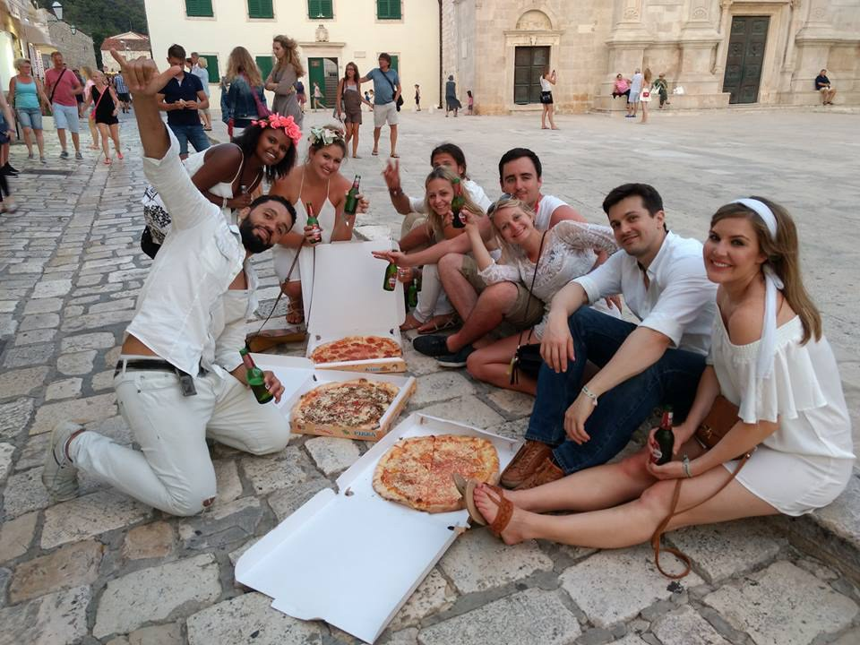 Kristin Komar and her friends eating pizza in the streets of Hvar.
