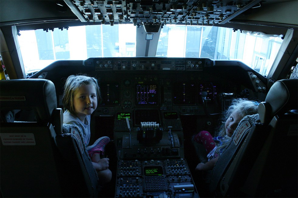 Two girls enjoy a seat in the cockpit of the 747 before the flight departed from Chicago's O'Hare Airport