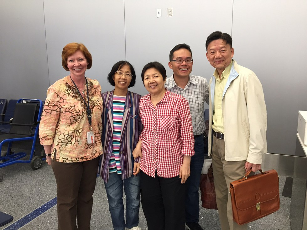 The Chang family, reunited. Hsiu-Mei Chang, Hsiu-Chun Chang and Tom Guu are pictured in the center