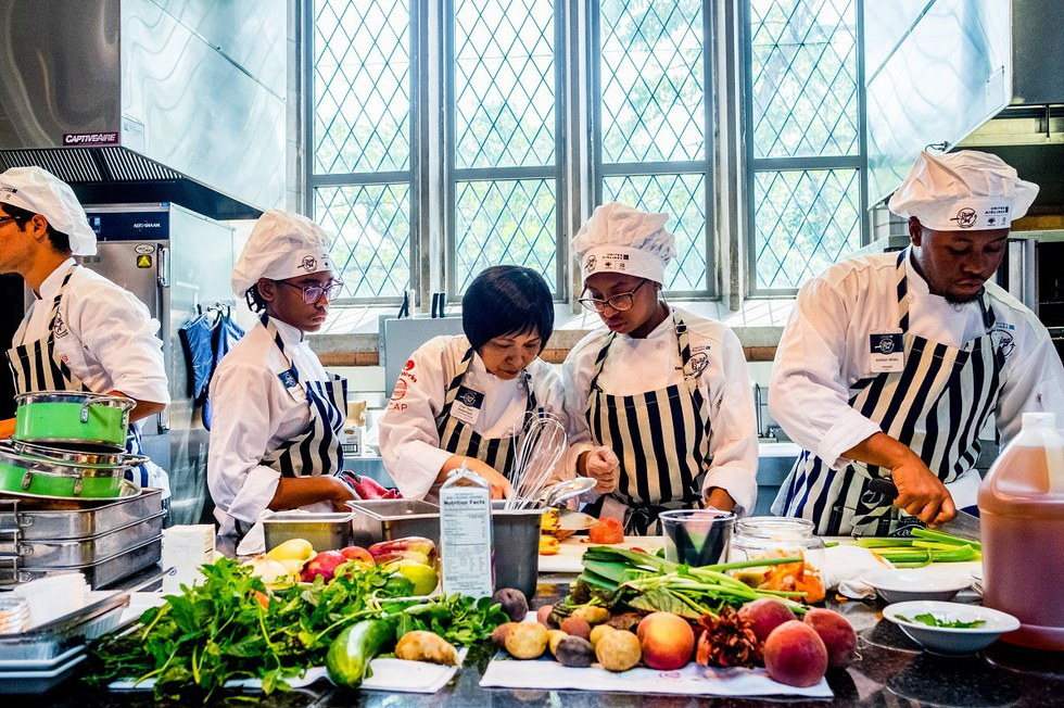 students receiving guidance from a local celebrity chef