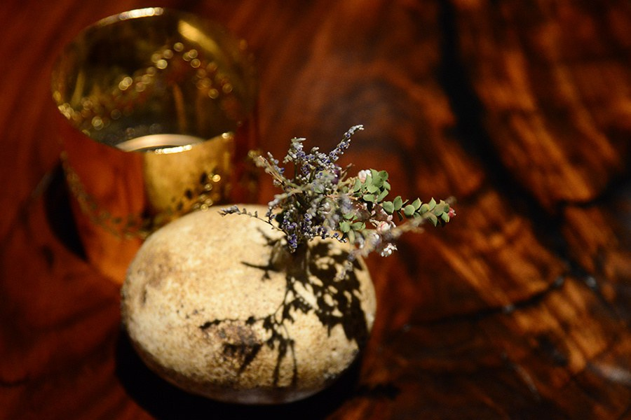 The centerpiece of each table: a tiny bouquet