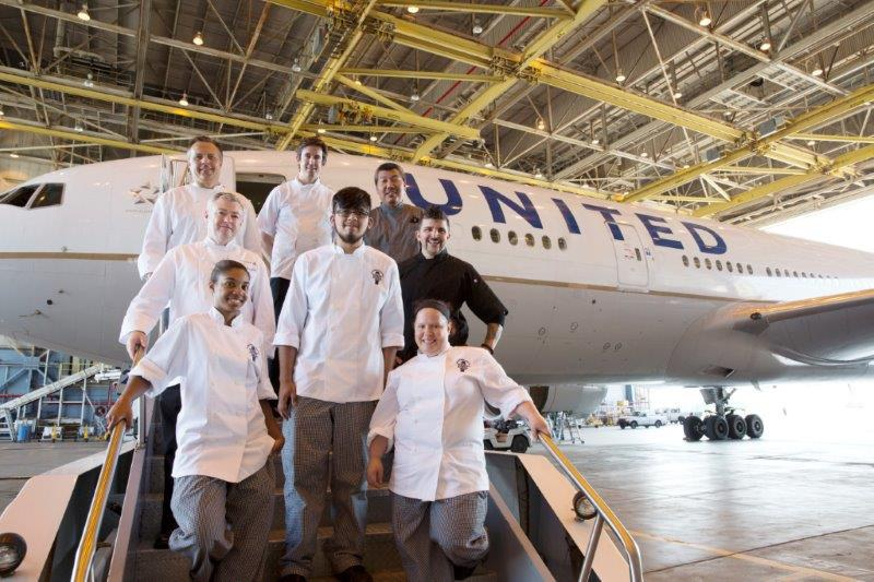 Charlie Trotter chefs in a United hangar