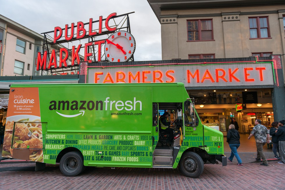 An Amazon Fresh truck in front of the famous Pike Place Market late in the