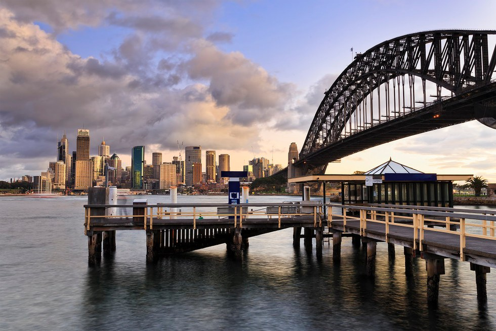 Wooden ferry pier with Sydney in the background
