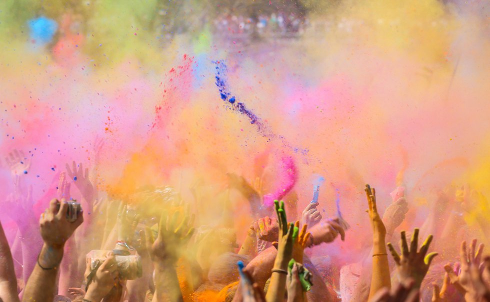 People throwing colorful powder at Holi Festival in India