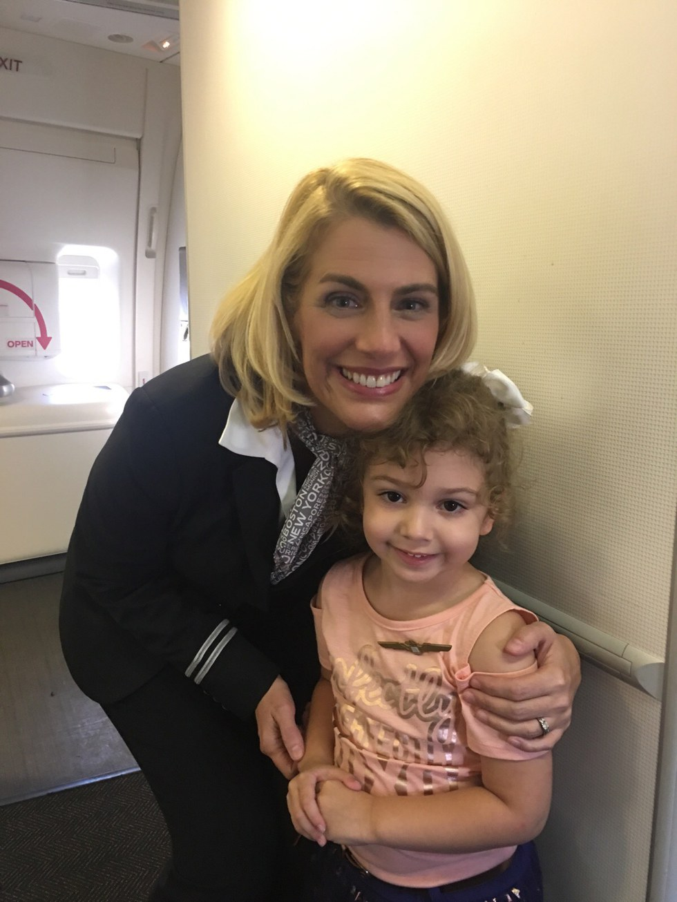 Boston-based Flight Attendant Sara Nelson with a small child been evacuated from Puerto Rico
