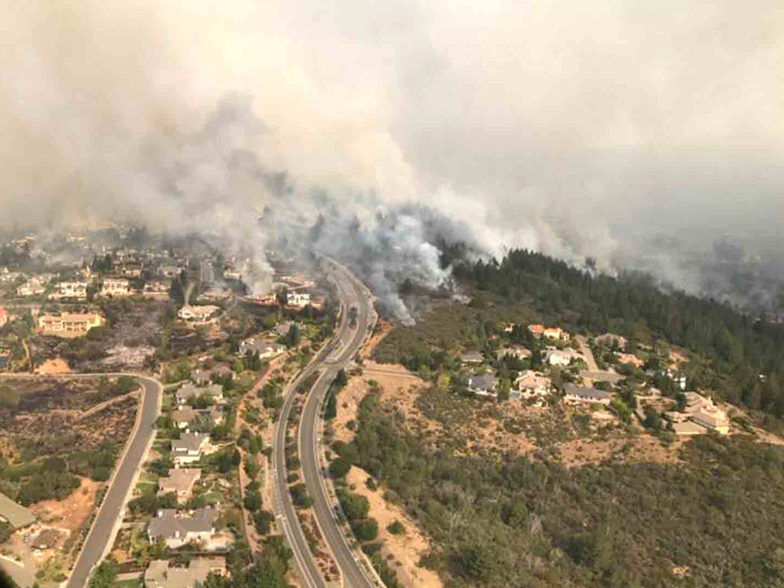 photo image 'Unprecedented' Wildfires Break Out in Northern and Southern California