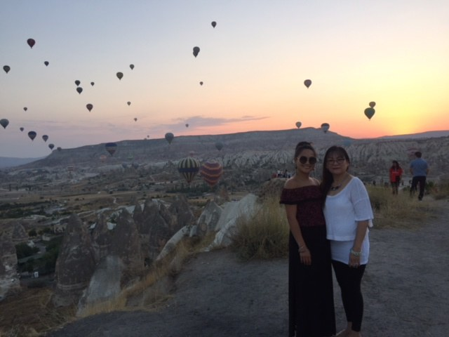 United employee and her mom watching the hot air balloons at sun rise