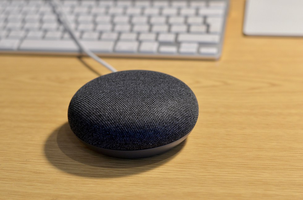 Picture of Google Home Mini on a desktop.