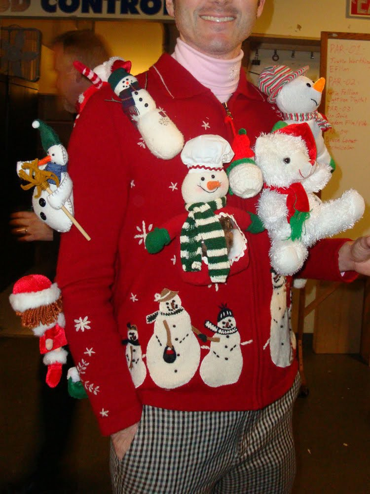 it looks like this guy just decided to see how many snowmen he could fit onto one sweater it turned out to be a really cool and unique sweater idea - Unique Christmas Sweaters