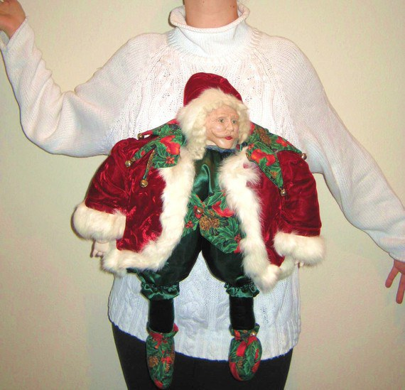 this christmas sweater is one of the strangest that ive ever seen the creepy santa face definitely makes a statement and its safe to say that no one - Best Ugly Christmas Sweaters Ever