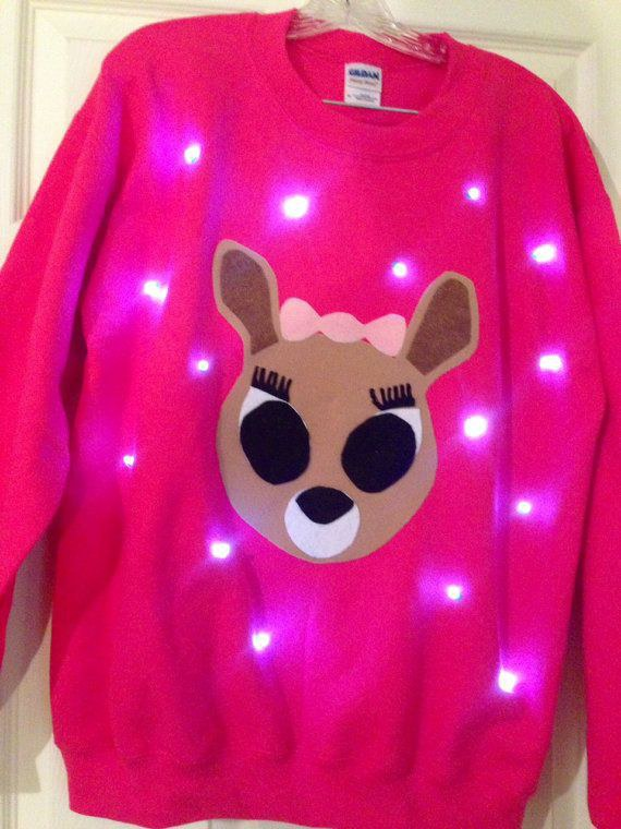 any sweater that lights up is definitely one you need to grab and wear to all of your ugly christmas sweater parties