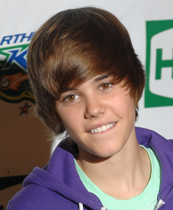 2010: The Bieber hair flip has made it another year. However, this year it  looks a bit more organized and styled. It's a little shorter.