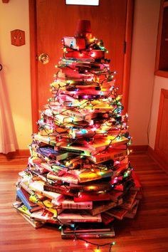 wipe the dust off those textbooks and build your own christmas tree at least youll get some use out of them this year