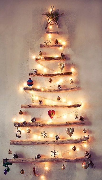 for the more earthy apartment you might try stringing branches together and stringing lights over them its bound to add a little rustic charm in the room - Best Way To String Lights On A Christmas Tree