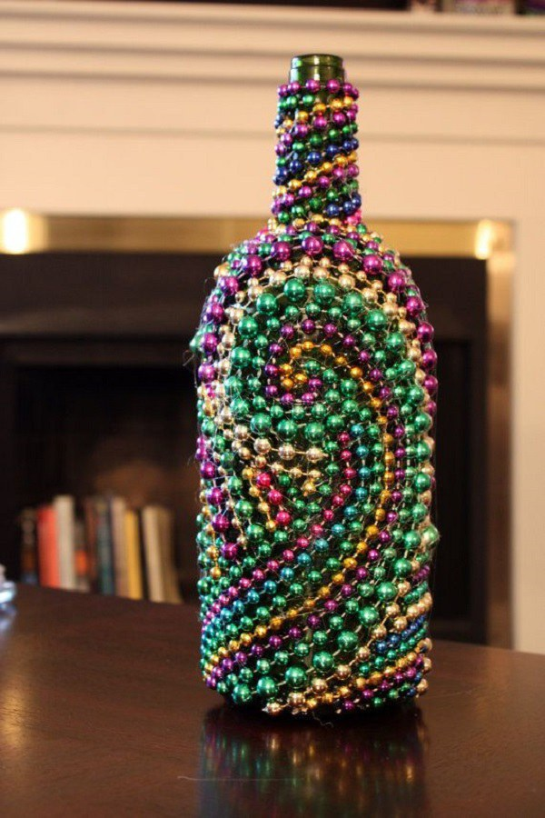 This Knocks Out Two Birds With One Stone You Re Finding A Creative Way To Recycle Your Old Wine Bottles And Reusing Mardi Gras Beads At The Same