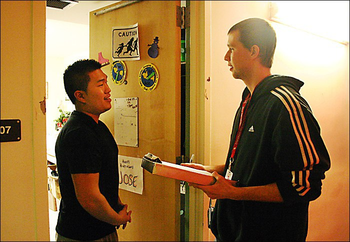 Resident Assistant speaking with student