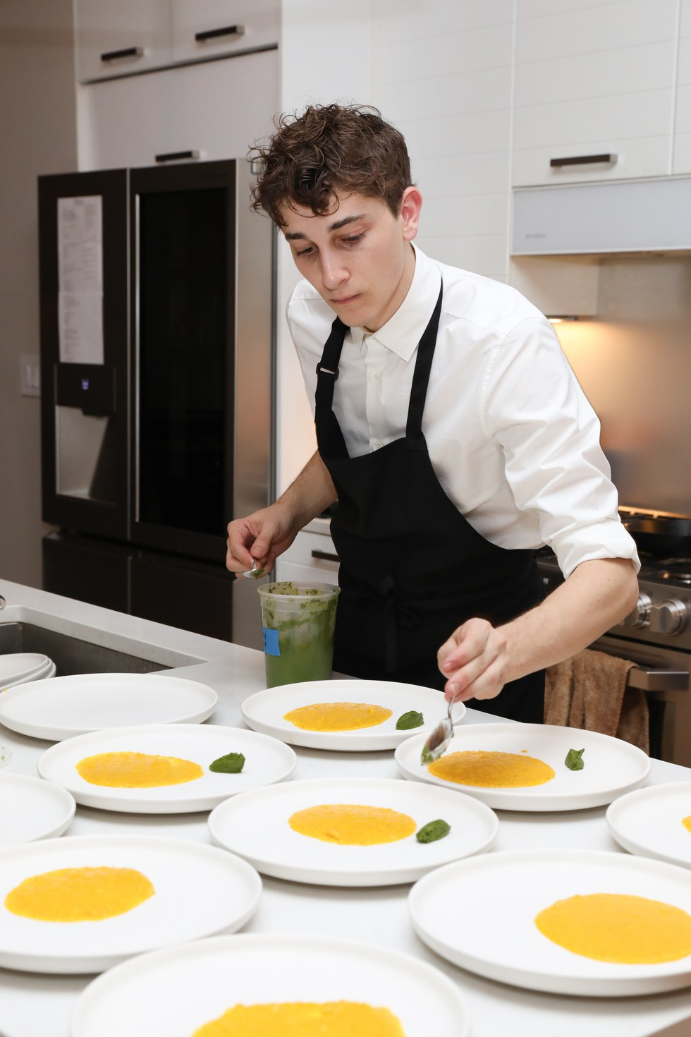 Jonah preparing a signature course at Pith Supper Club with help of LG SIGNATURE