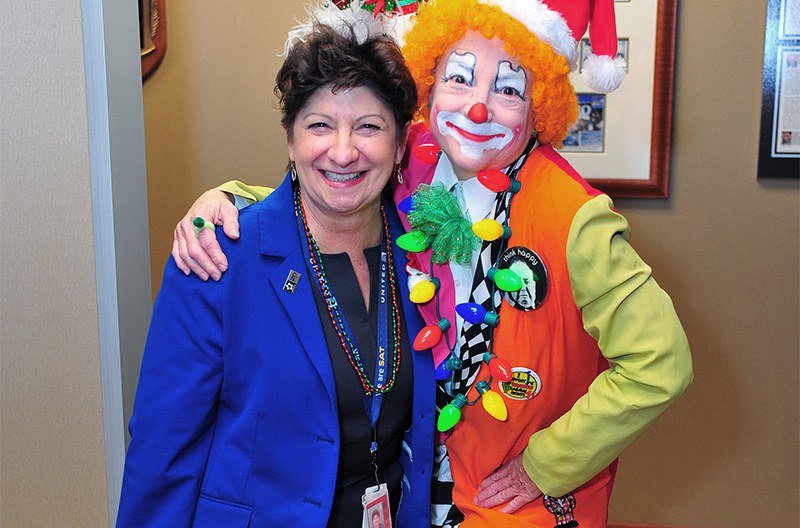 Beth Reininger with an employee dressed up as a clown.