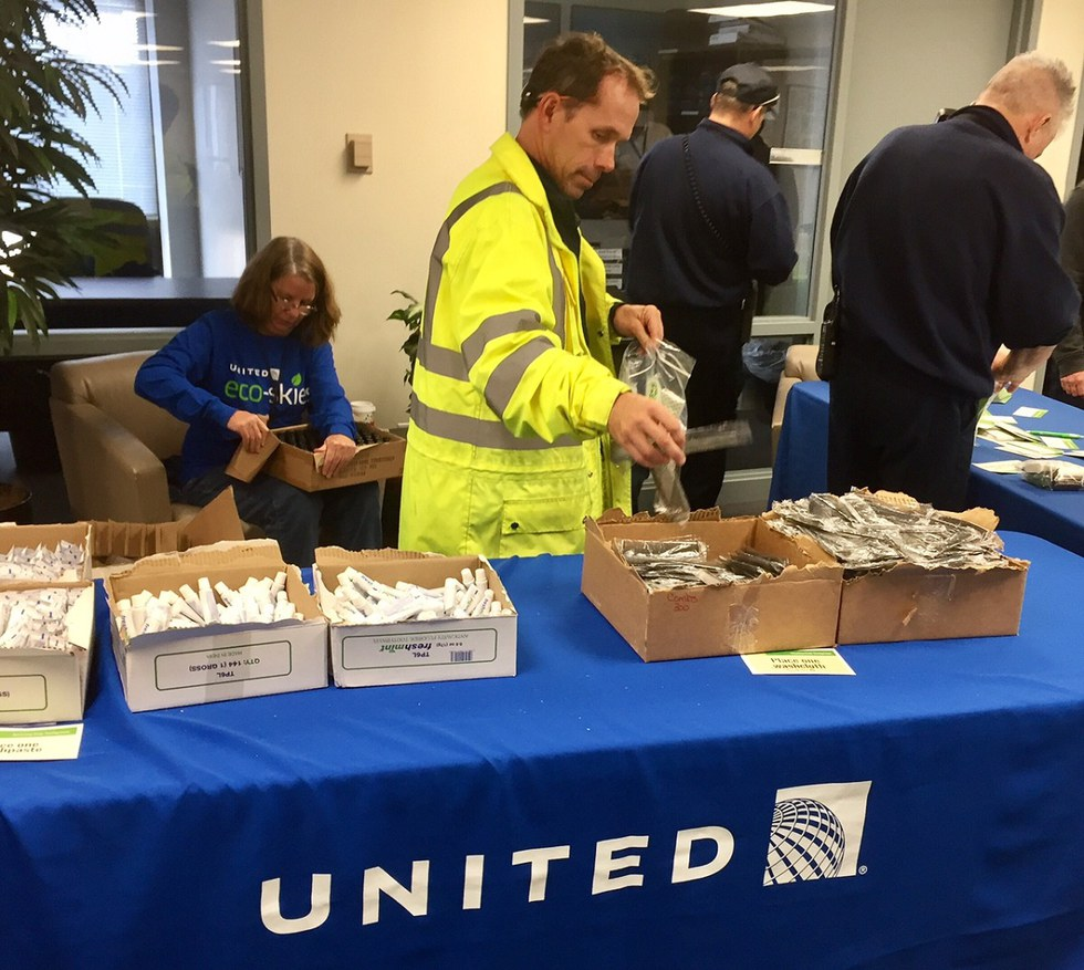 United employees assembling hygeine kits at Cleveland airport.