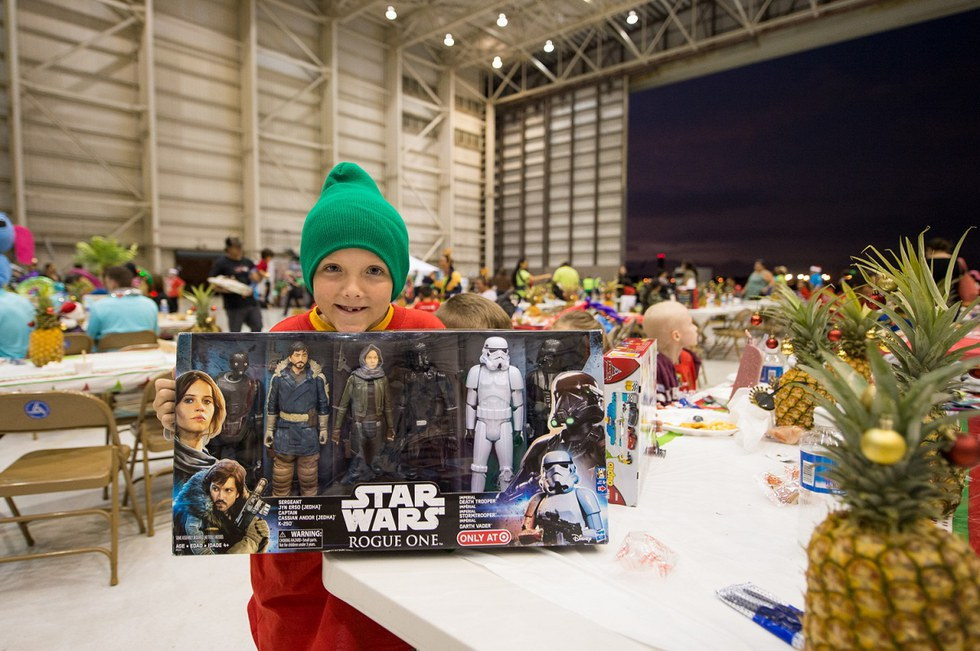 Little boy at the Honolulu Fantasy Flight with his gift