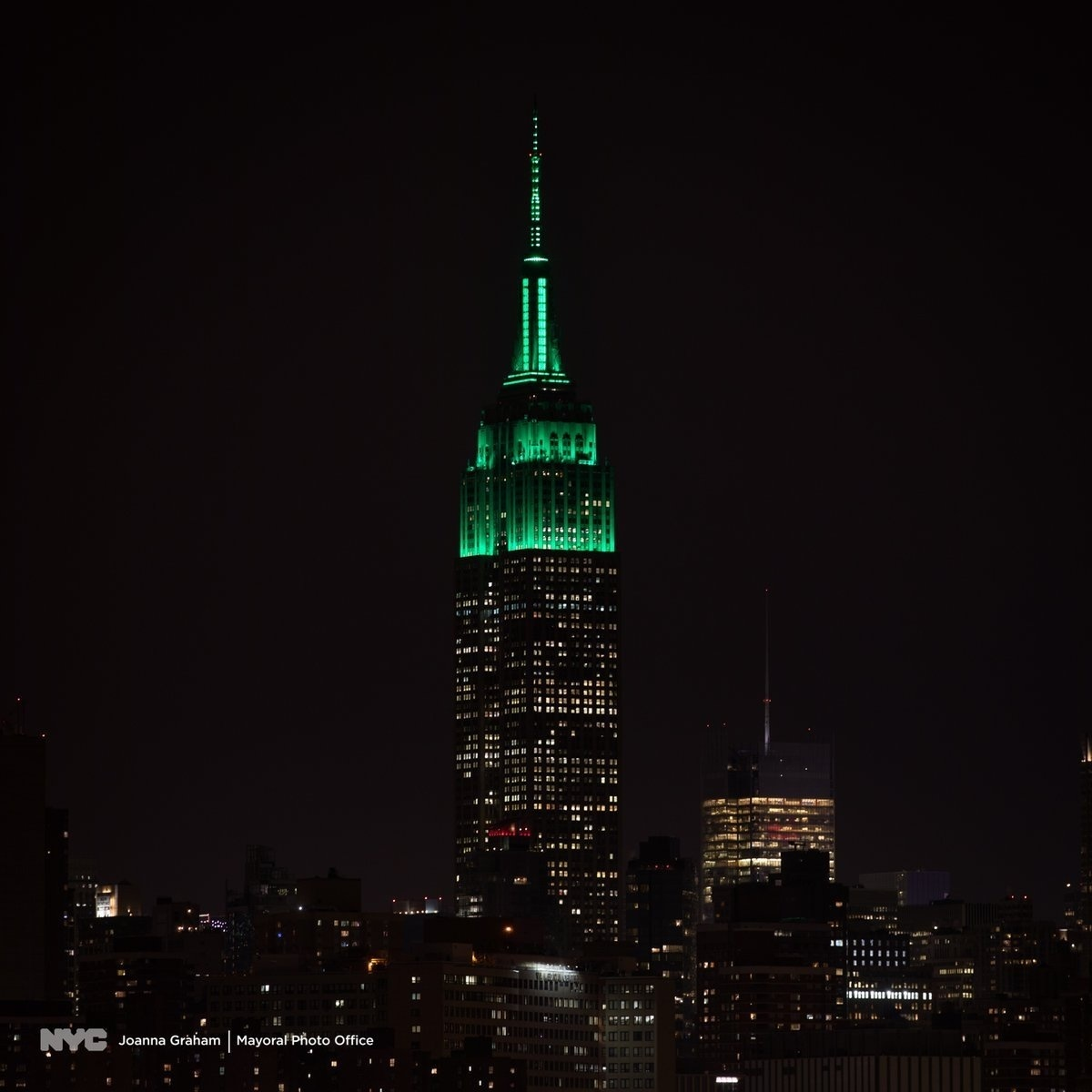 photo image Empire State Building Shines Green After NYC's Decision to Take on Fossil Fuel Industry