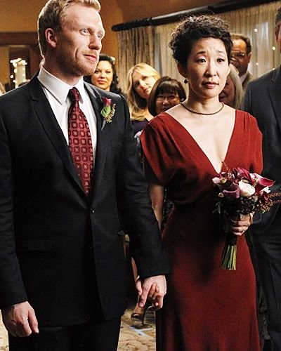 I Love That Cristina Wore A Non Traditional Wedding Dress Her Curls And Red Accented Witty Strong Willed Personality