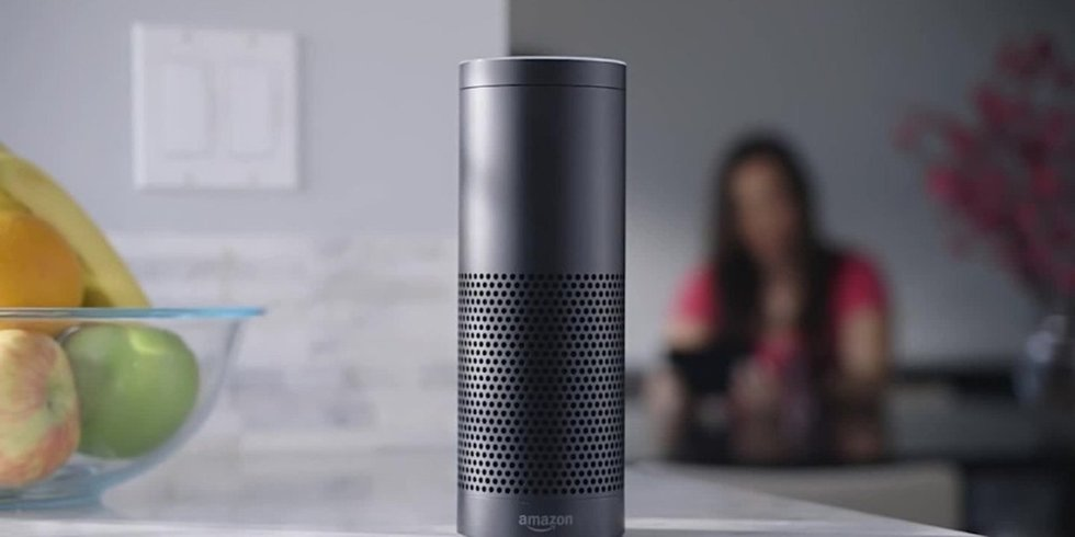 Picture of Amazon Echo on a table top.