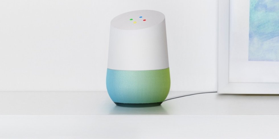 Picture of Google Home with Google Assistant on a shelf.