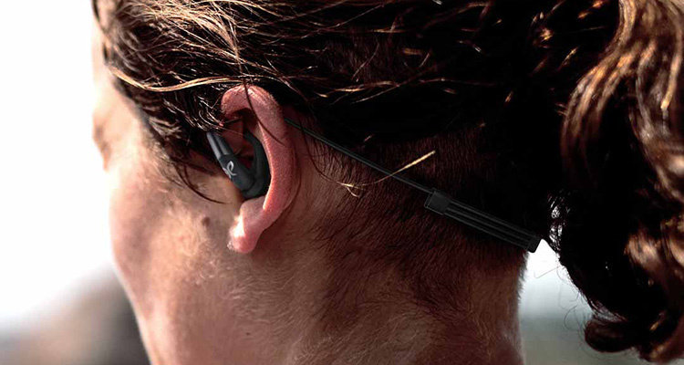 Picture of woman wearing Jaybird Freedom 2 earbuds.