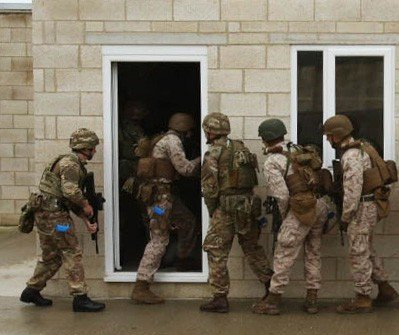 us marines and british royal commandos enter a building together in the first phase of security forces training in new castle upon tyne england sept