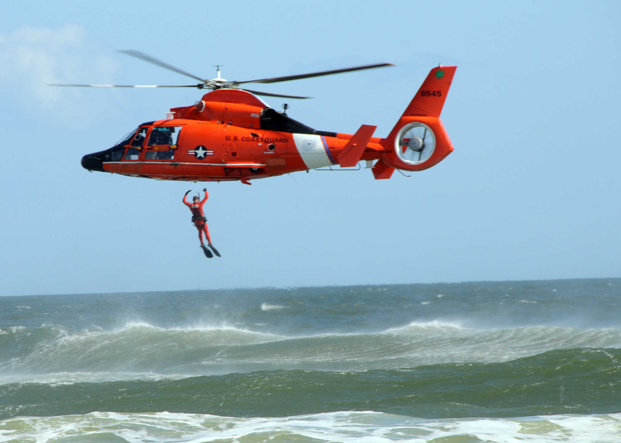 the us coast guard demonstrates how they conduct a search and rescue during the 2009 sea and sky spectacular us navy photo by mass communication