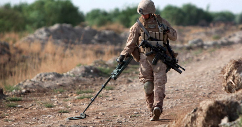 this us marine carefully sweeps his valon metal detector from side to side with the hopes of finding an ied before it finds his patrol