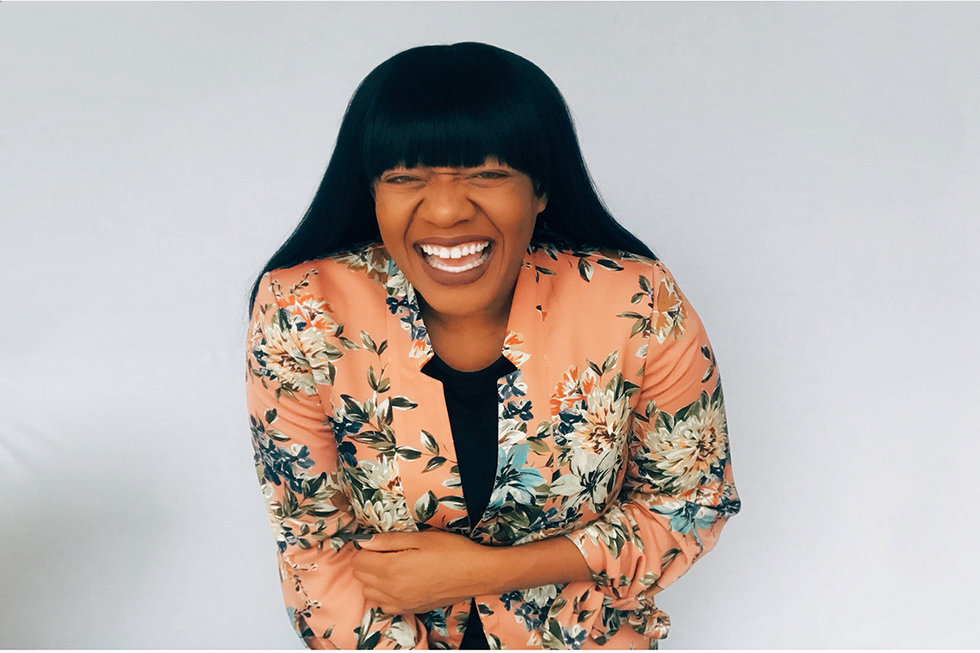 United's Dr. Christine Izuakor laughing