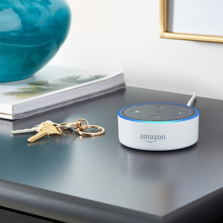 Picture of amazon echo dot 1st gen on a night stand with keys.