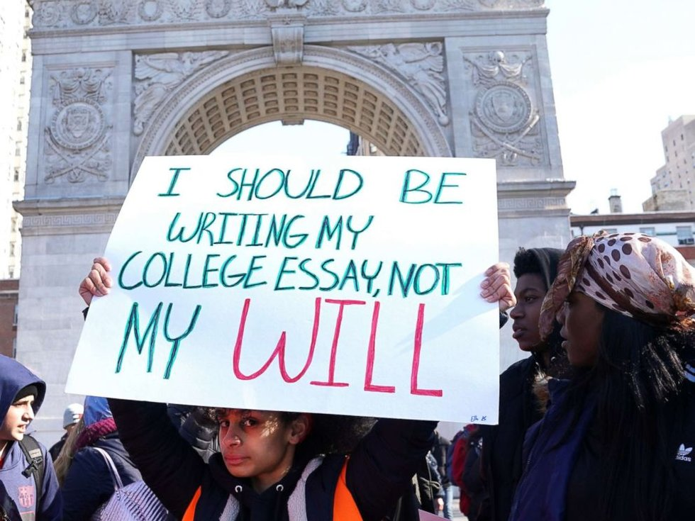 a sign held by one student read i should be writing my college essay not my will another sign read fix this before i have to text my mom from under a