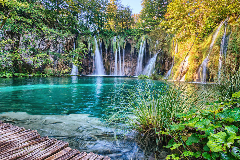 Waterfulls along a path in Plitvice Lakes National Park in Croatia.