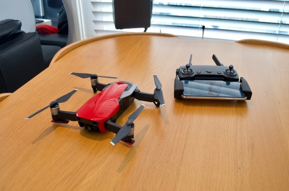 Picture of DJI Mavic Air drones on a table.