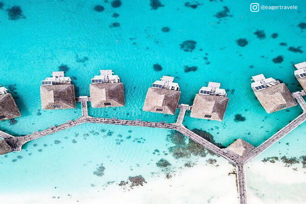 Aeriel shot of overwater bungalows in French Polynesia