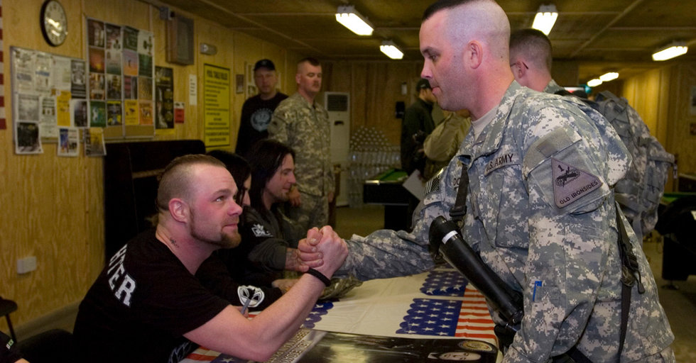 Pfc John Dothage Meets Five Finger Death Punch After They Performed For US Troops At Camp Stryker Baghdad March 3 2010 Army Photo By Staff Sgt