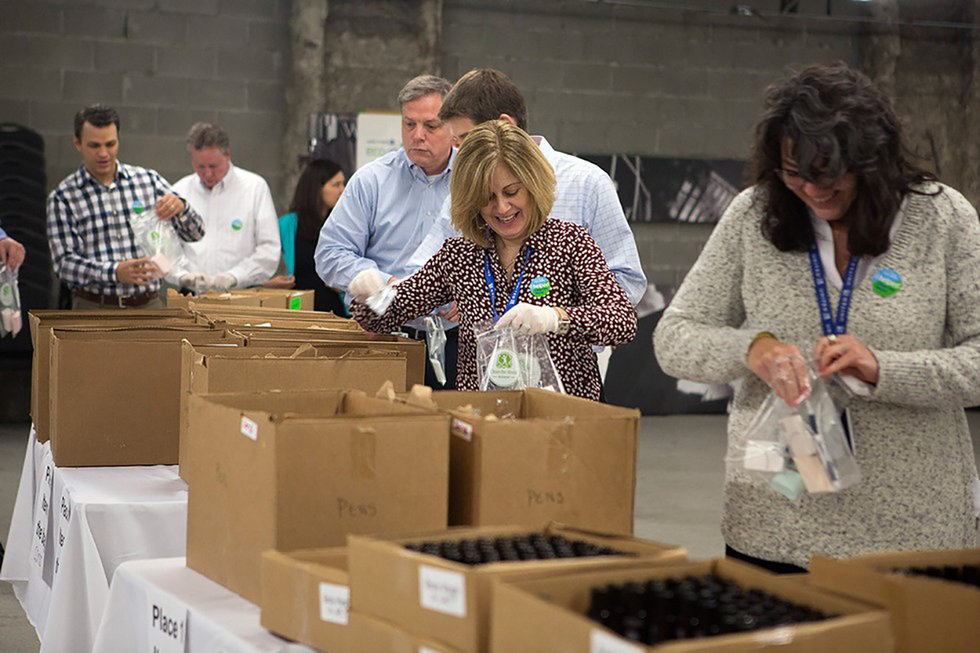 United employees putting together recycled items for Clean the World.