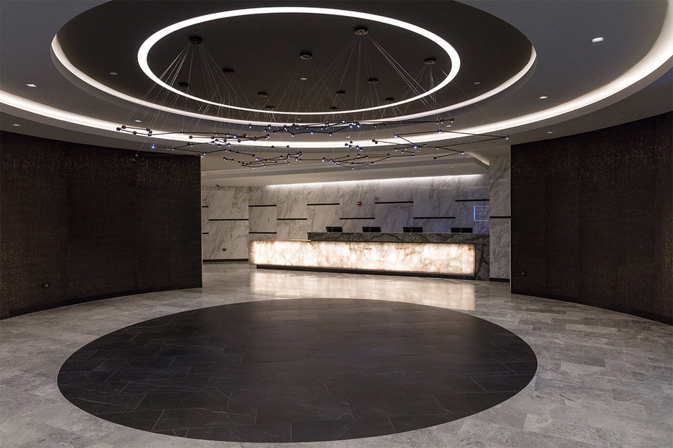 The lighting fixture that mimics the constellations of the 12 zodiac signs in the entry of the new United Polaris lounge at EWR