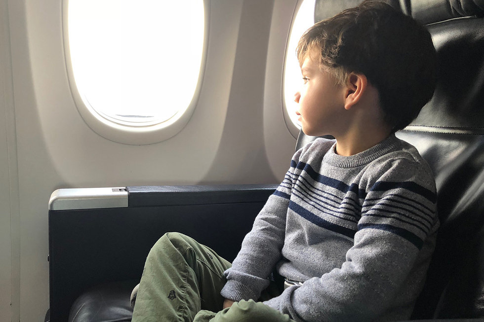 Justin's son looks out the window on a United flight