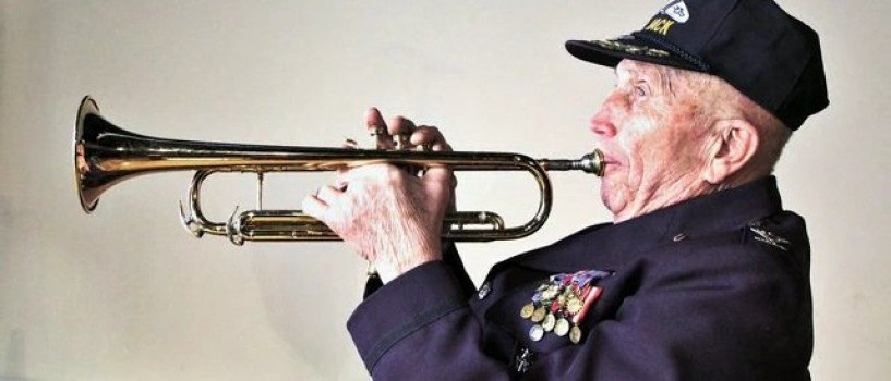 Jack Tuler holding his trumpet, at 90 (maniacworld)