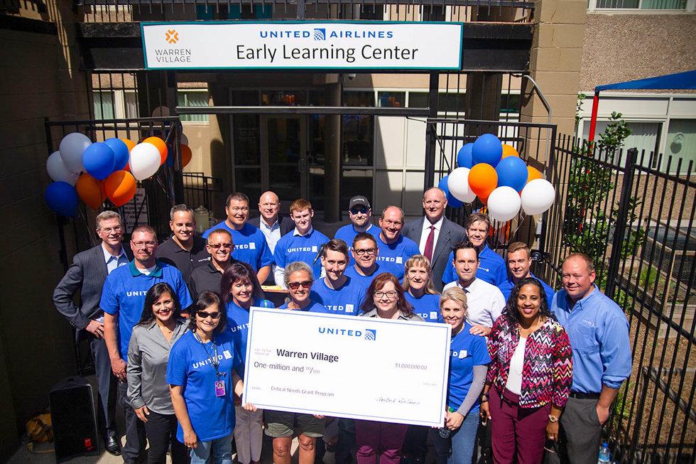 Employees receiving the million dollar check for Warren Village in Denver