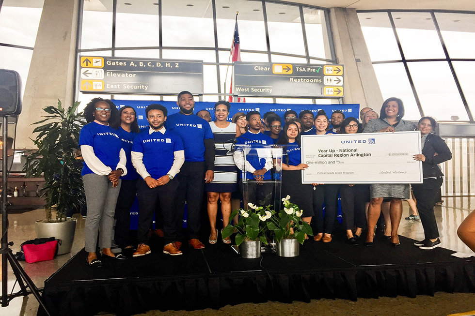 United employees and members of Year Up accepting the grant