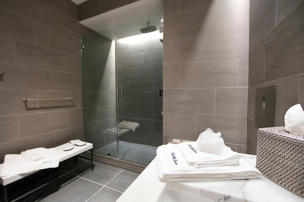 The shower suite at the new United Polaris\u00ae lounge at IAH
