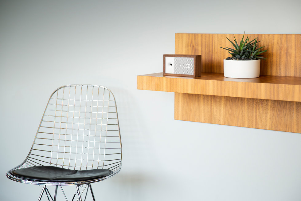Picture of Awair air monitor on a shelf.