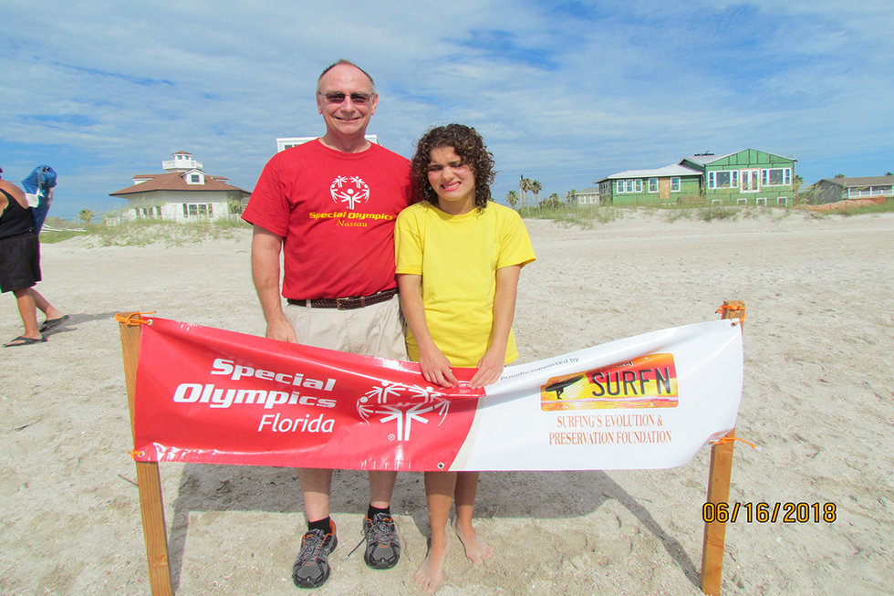 Alissa and her dad at one of the surf competitions.